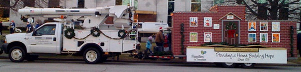 photo of ECEC bucket truck towing parade float
